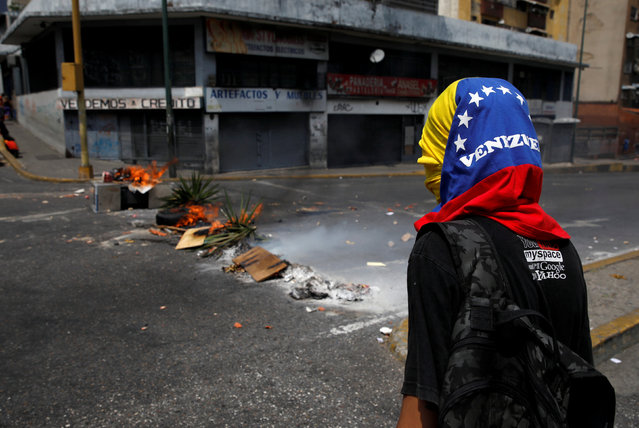 A demonstrator takes part in a protest against the government of Venezuelan President Nicolas Maduro in Caracas, Venezuela March 31, 2019. (Photo by Carlos Garcia Rawlins/Reuters)