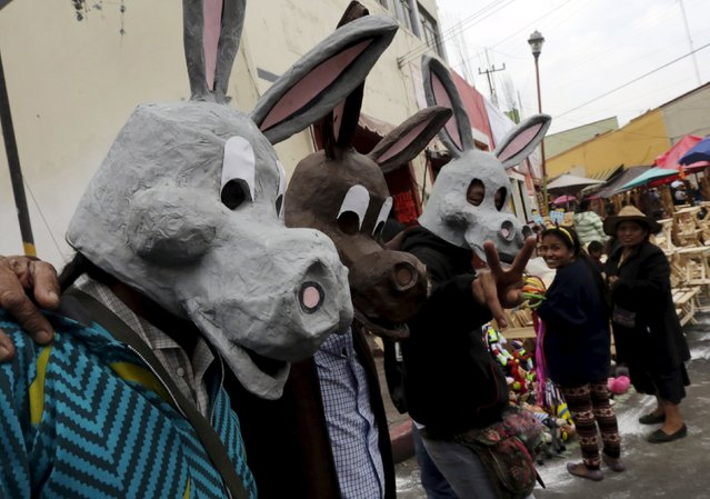 People wearing donkeys masks take part in the annual donkey festival in Otumba, near Mexico City, May 1, 2015. (Photo by Henry Romero/Reuters)