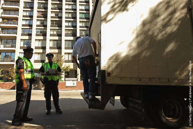 Police officers search a truck