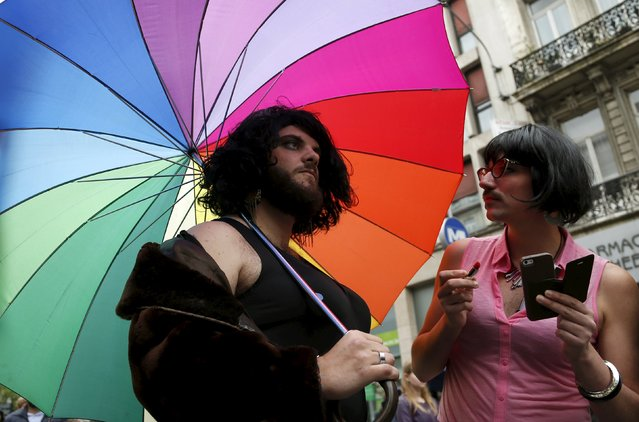 Participants stand under a rainbow umbrella as they attend the Belgian lesbian, gay, bisexual and transgender (LGBT) Pride Parade in Brussels, Belgium, May 16, 2015. (Photo by Francois Lenoir/Reuters)