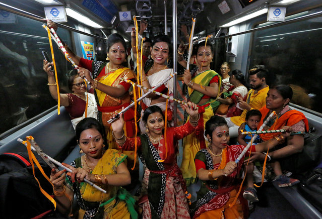 Women, who according to the organisers are suffering from Thalassaemia, perform inside a running Metro train to celebrate the 158th birth anniversary of Nobel Prize winning poet Rabindranath Tagore in Kolkata, India, May 9, 2019. (Photo by Rupak De Chowdhuri/Reuters)