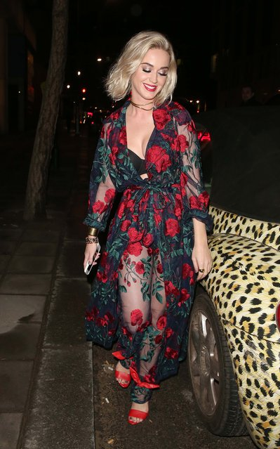 Katy Perry is seen here leaving The Brits afterparty for Universal Records in London at 180 The Strand via a back door a stopping for pictures with a leopard print car in a seductive pose for the paparazzi cameras on February 22, 2017. Katy was wearing a lace red & green floral dress. (Photo by WeirPhotos/Splash News)