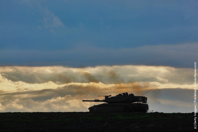 An Israeli army Merkeva tank advances at a firing range
