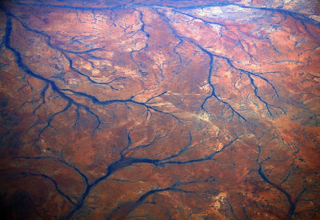 A general view of dried-up rivers in the Pilbara region of Western Australia December 2, 2013. Western Australia's Pilbara region, which is the size of Spain, has the world's largest known deposits of iron ore and supplies nearly 45 percent of global trade in the mineral. (Photo by David Gray/Reuters)