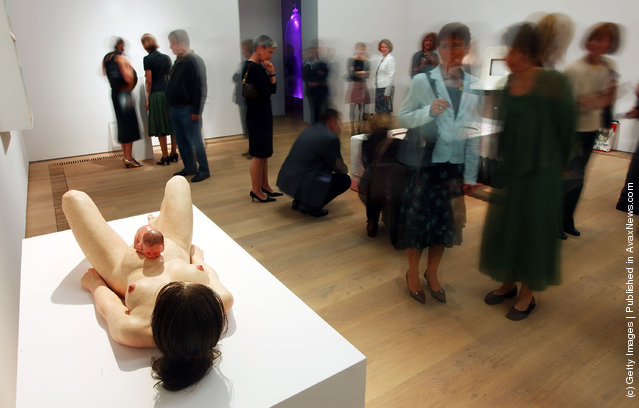 Visitors gather in front of Ron Mueck's sculpture Mother And Child