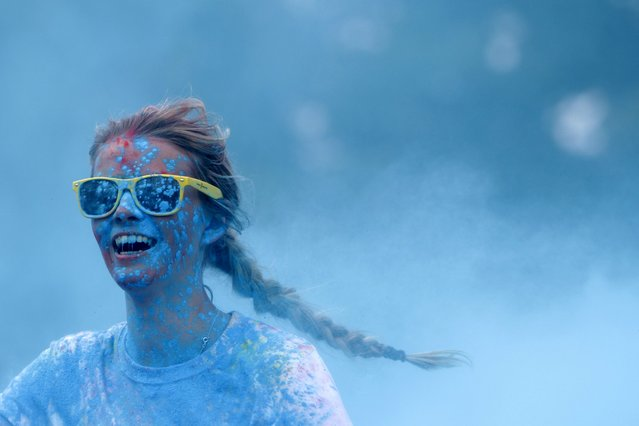 A participant runs through colored powder as she takes part in the Get Rainbowed run in Prague May 23, 2015. (Photo by David W. Cerny/Reuters)