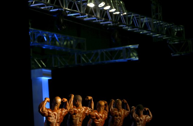 Professional bodybuilders pose during the Arnold Classic Brazil 2015 in Rio de Janeiro, May 30, 2015. REUTERS/Ricardo Moraes