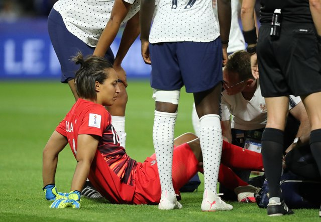France goalkeeper Sarah Bouhaddi grimaces in pain after been fouled during the Women's World Cup round of 16 soccer match between France and Brazil at the Oceane stadium in Le Havre, France, Sunday, June 23, 2019. (Photo by Lucy Nicholson/Reuters)