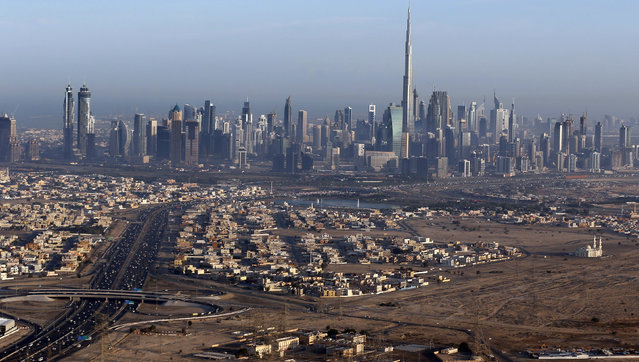 Burj Khalifa, the world's tallest tower, is seen in a general view of Dubai, UAE December 9, 2015. (Photo by Karim Sahib/Reuters)