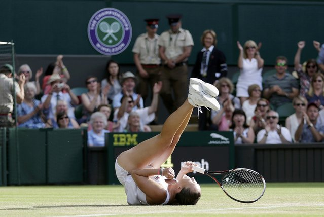 Jelena Jankovic of Serbia celebrates after winning her match against Petra Kvitova of the Czech Republic at the Wimbledon Tennis Championships in London, July 4, 2015. (Photo by Henry Browne/Reuters)