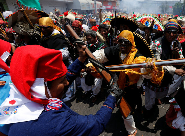 Mexicans wearing period costumes re-enact the battle of Puebla in the Penon de los Banos neighbourhood of Mexico City, Mexico, May 5, 2016. (Photo by Henry Romero/Reuters)