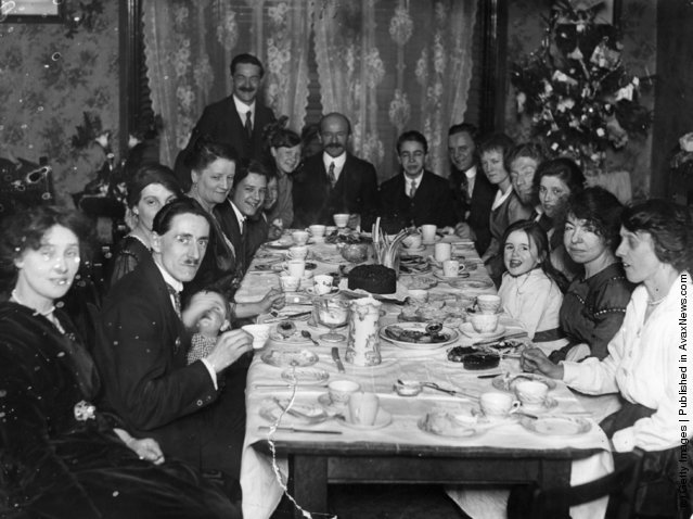 1919: A family sitting down for tea at Christmas time