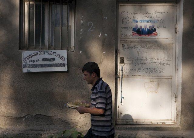 A man walks in a street in Leningori (or Akhalgori), in the breakaway region of South Ossetia, Georgia, July 6, 2015. (Photo by Kazbek Basaev/Reuters)