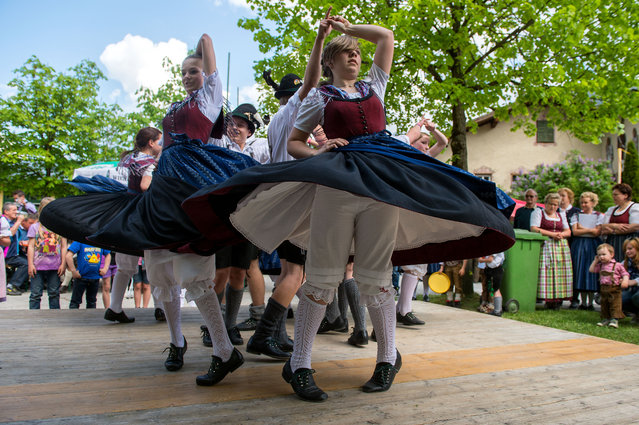 Traditionally dressed dancers perform during the May Day celebrations in Lofer in the Austrian province of Salzburg, on Thursday, May 1, 2014. (Photo by Kerstin Joensson/AP Photo)