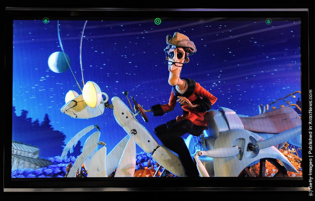 A glasses-free Toshiba 55-inch 3-D 4x full HD TV shows the movie, 'Coraline' at the 2012 International Consumer Electronics Show