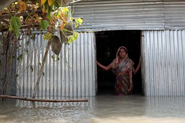 Saju Begum, a flood-affected woman poses for a picture inside her house in Jamalpur, Bangladesh, July 21, 2019. (Photo by Mohammad Ponir Hossain/Reuters)