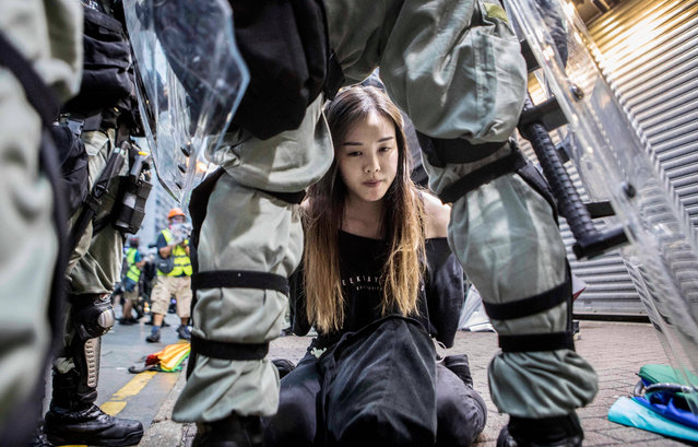 "A young female demonstrator is arrested by police during clashes in the Causeway Bay area of Hong Kong, China on October 6, 2019. Hundreds of thousands of protesters marched through the city's streets in defiance of the new ""no-mask"" law, which was introduced two days ago as demonstrations roll into a 14th week. (Photo by Rick Findler/EPA/EFE/Rex Features/Shutterstock)"