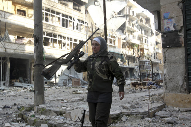 Guevara, a Syrian Palestinian woman married to an Al Wa'ad battalion commander, is pictured in Aleppo January 19, 2013. Guevara was the director of a secondary school before the revolution and is now one of the main snipers of the battalion on the front line in Aleppo. (Photo by Muzaffar Salman/Reuters)
