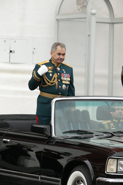 Russian Defense Minister Sergei Shoigu crosses himself as he is driven along Red Square during the Victory Day military parade to celebrate 72 years since the end of WWII and the defeat of Nazi Germany, in Moscow, Russia, on Tuesday, May 9, 2017. (Photo by Ivan Sekretarev/AP Photo)