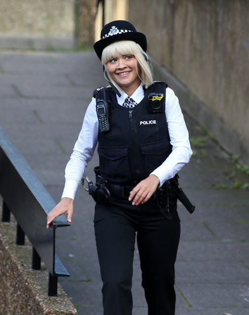 Rita Ora wears a police uniform while Jude Law's son Rafferty displays his agility as the pair are seen on the set of modernized Oliver! remake for the first time on the streets of London, UK on October 22, 2019. (Photo by Crystal Pix/Timmie/Backgrid UK)