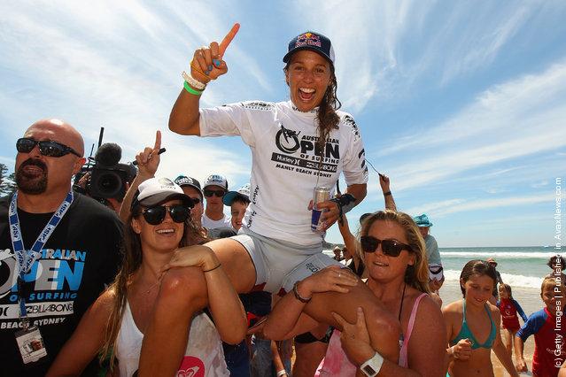 Sally Fitzgibbons of Australia celebrates winning the Women's Final of the 2012 Australian Surfing Open
