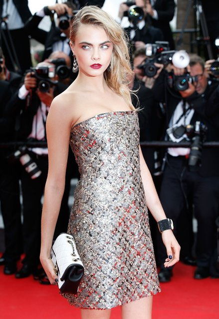 """British model and actress Cara Delevingne poses as she arrives for the screening of the film """"The Search"""" at the 67th edition of the Cannes Film Festival in Cannes, southern France, on May 21, 2014. (Photo by Valery Hache/AFP Photo)"""