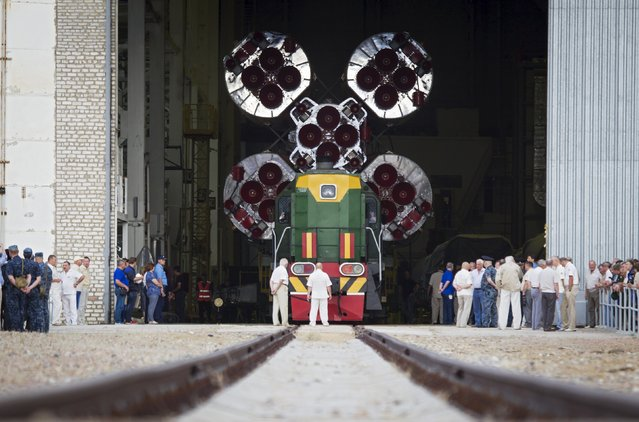The Soyuz TMA-17M spacecraft is ready to be transported from an assembling hangar to its launch pad at the Baikonur cosmodrome, Kazakhstan, July 20, 2015. The Soyuz is scheduled to blast off with Kjell Lindgren of the U.S., Kimiya Yui of Japan and Oleg Kononenko of Russia to the International Space Station on July 23, 2015. (Photo by Shamil Zhumatov/Reuters)