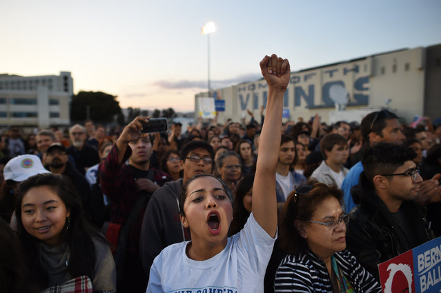 UCLA student, Maral Milani, center, cheers for presidential candidate, Bernie Sanders as he speaks at a rally at Santa Monica High School on Monday May 23, 2016 in Santa Monica, CA. The primary in California is June 7th. (Photo by Matt McClain/The Washington Post)