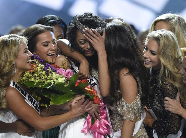 Miss District of Columbia USA Kara McCullough, center, reacts with fellow contestants after she was crowned the new Miss USA during the Miss USA contest Sunday, May 14, 2017, in Las Vegas. (Photo by David Becker/Reuters)