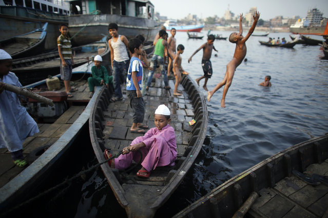 Children play at a shipyard by the river Buriganga, on the outskirts of Dhaka May 19, 2014. (Photo by Andrew Biraj/Reuters)