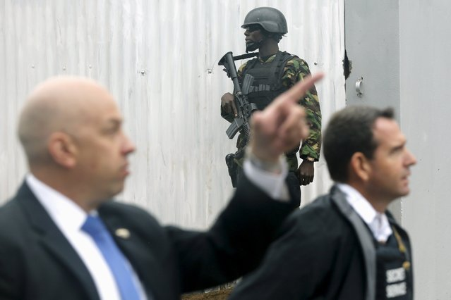 A soldier and U.S. Secret Service agents patrol outside the hotel where U.S. President Barack Obama is staying in Nairobi July 25, 2015. Obama is visiting Kenya, his father's home country, to address the Global Entrepreneurship Summit and to meet with Kenya's President Uhuru Kenyatta. (Photo by Jonathan Ernst/Reuters)