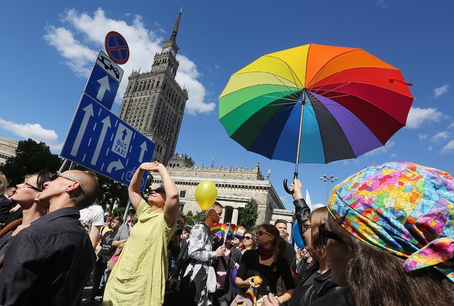 Thousands of Warsaw residents with rainbow flags walk in a colourful annual Equality Parade to show their support for sexual minority groups in Warsaw, Poland, Saturday, June 11, 2016. (Photo by Czarek Sokolowski/AP Photo)
