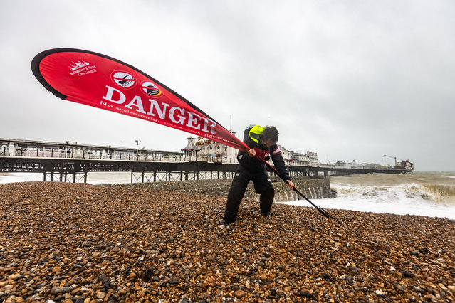 Brighton seafront manager Chris Ingalls secures Danger signs on Brighton Beach as Storm Brendan batters the south coast on January 14, 2020. (Photo by Jon Santa Cruz/Rex Features/Shutterstock)