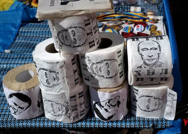 "A picture taken on July 6, 2014 shows rolls of toilet paper printed with the picture of Russian President Valdimir Putin in Kiev's Independence Square, the so-called ""Maidan"". (Photo by Dominique Faget/AFP Photo)"