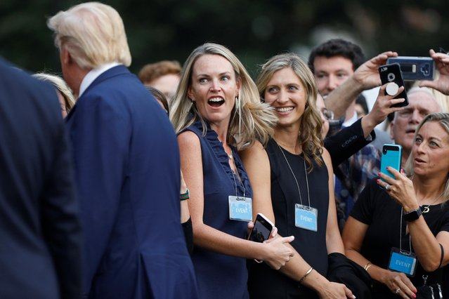 Supporters react as U.S. President Donald Trump walks from Marine One to the White House in Washington, U.S., October 3, 2019. (Photo by Tom Brenner/Reuters)