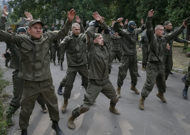 "New volunteers for the Ukrainian interior ministry's ""Azov"" battalion prepare to take part in tests before heading to frontlines in eastern Ukraine, at the battalion's training centre in Kiev, Ukraine, August 14, 2015. (Photo by Gleb Garanich/Reuters)"