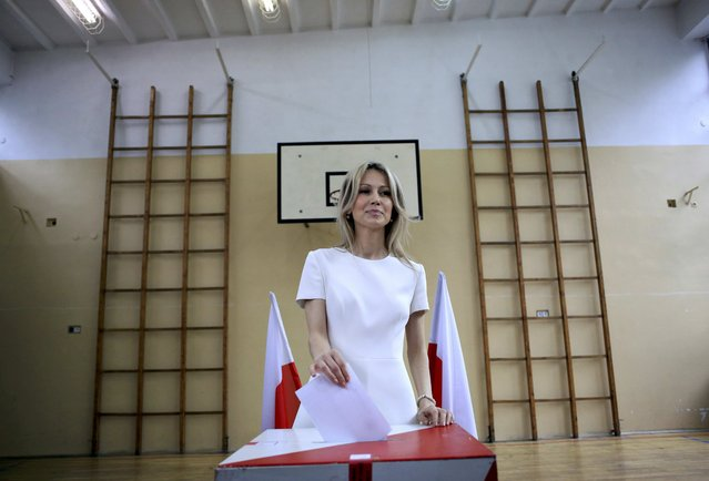 Presidential candidate Magdalena Ogorek casts her vote in the first round of the Presidential election at a polling station in Warsaw, Poland May 10, 2015. (Photo by Jacek Marczewski/Reuters)
