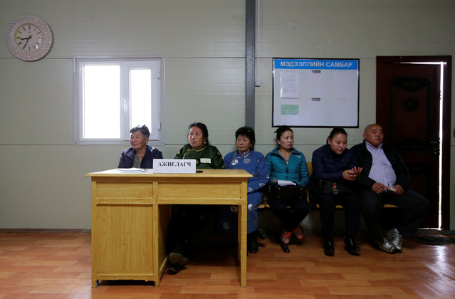 Local villagers, as polling observers for the parliamentary elections, sit in a polling station on the outskirt of Ulaanbaatar, Mongolia, June 29, 2016. (Photo by Jason Lee/Reuters)