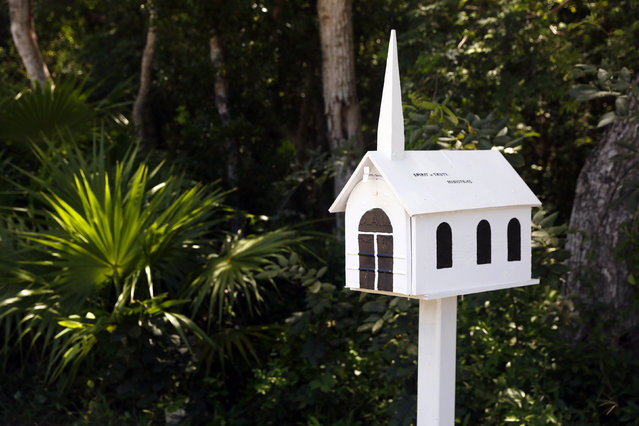 A mailbox in the shape of a church is seen outside a chapel along the highway US-1 in the Lower Keys near Key Largo in Florida, July 11, 2014. (Photo by Wolfgang Rattay/Reuters)
