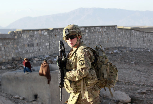 SPC Erica Taliaferro, a U.S. female soldier from 549th MP Company, Task Force Bronco patrols in Pachir wa Agam district in Nangarhar province, eastern Afghanistan, March 5, 2012. (Photo by Erik De Castro/Reuters)