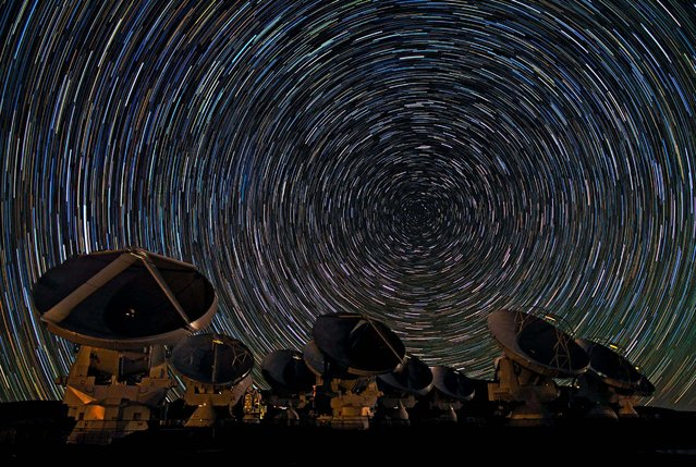 Honorable Mention, Pictorial. Photo by Babak A. Tafreshi, Eso/Rex Features/ZumaPress.com: The antennas of the Atacama Large Millimeter/Submillimeter Array under the southern sky in Chile.The dramatic whirls of stars in the sky show the rotation of the Earth. (Photo by Babak A. Tafreshi)