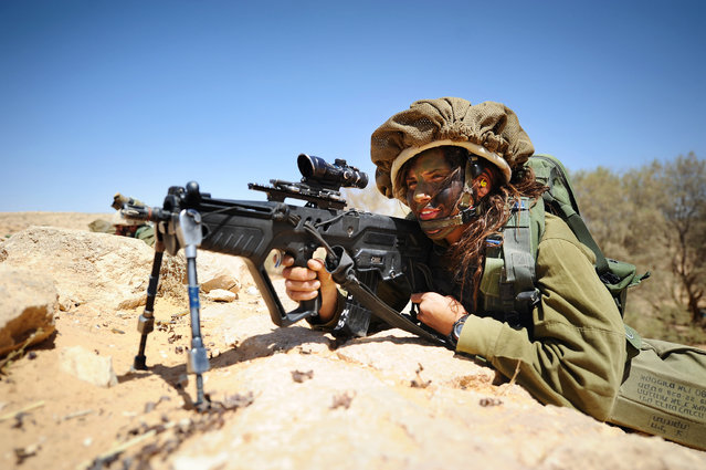 """Aiming"". Soldiers of the Caracal co-ed battalion during a platoon exercise in southern Israel, 2012."