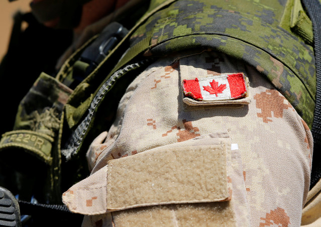 A Canadian soldier from the Royal 22nd Regiment wears a Maple Leaf flag on his uniform during a non-combative extraction operation as part of Rim of the Pacific (RIMPAC) 2016 exercise held at Camp Pendleton, California United States, July 11, 2016. (Photo by Mike Blake/Reuters)