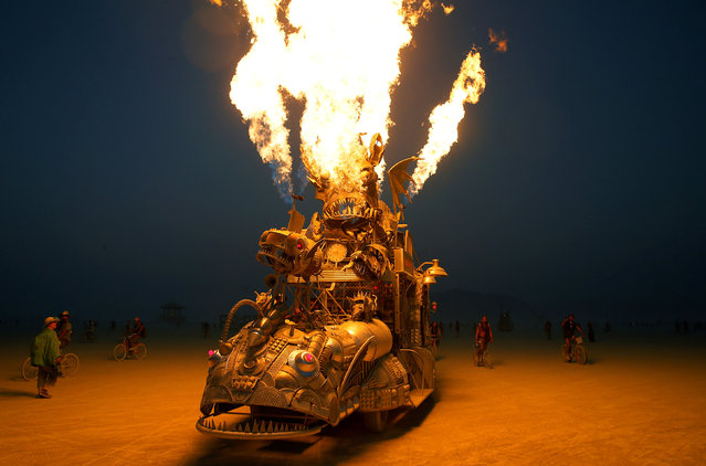 "The ""Rabid Transit"" Burning Man art car erupts with flames from it's onboard propane poofers during the 4th day of the annual Burning Man arts and music festival in the Black Rock Desert of Nevada, U.S., August 31, 2017. (Photo by Jim Bourg/Reuters)"