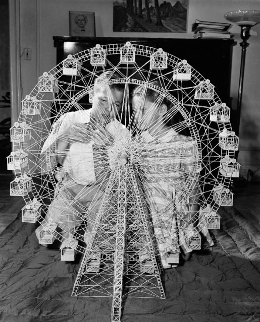 14-year-old Barry Pariser, checks on the movable ferris wheel which he built out of toothpicks as his sister Linda looks on in New York, September 6, 1948. This is the young hobbyist's most ambitious project, which took 27,000 toothpicks and four months to build. Barry began his toothpick building at the age of ten, at the suggestion of his father. (Photo by Ed Ford/AP Photo)