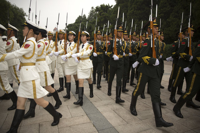 Chinese honor guard members march in formation before a welcome ceremony for Brunei's Sultan Hassanal Bolkiah at the Great Hall of the People in Beijing, Wednesday, September 13, 2017. (Photo by Mark Schiefelbein/AP Photo)