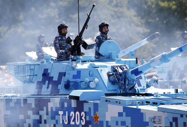 China's People's Liberation Army (PLA) navy soldiers stand on armored vehicles during the military parade to mark the 70th anniversary of the end of World War Two, in Beijing, China, September 3, 2015. (Photo by Damir Sagolj/Reuters)