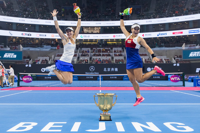 Switzerland' s Martina Hingis, left, and Taiwan' s Chan Yung- Jan celebrate with the trophy after winning over Timea Babos of Hungary and Andrea Hlavackova of the Czech Republic after the final of the women' s doubles in the China Open tennis tournament at the Diamond Court in Beijing, China, Sunday, October 8, 2017. (Photo by Reuters/China Stringer Network)