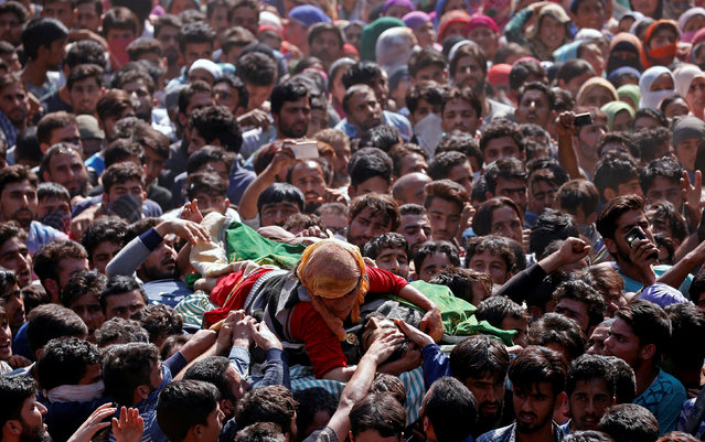 A woman clings to the body of Nasrullah Mir, a suspected militant, who according to the local media was killed during a gun battle with Indian security forces in the Hajin area of Bandipora district, Kashmir, October 11, 2017. (Photo by Danish Ismail/Reuters)