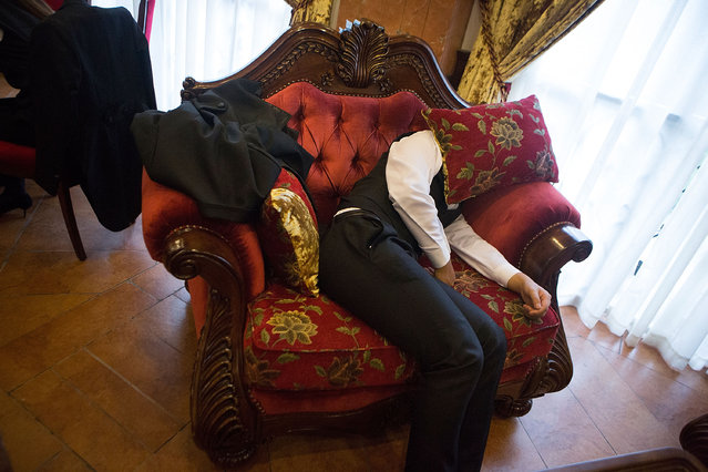Students take a nap during their break after working a 14 hour shift at The International Butler Academy China on September 16, 2014 in Chengdu, China. (Photo by Taylor Weidman/Getty Images)